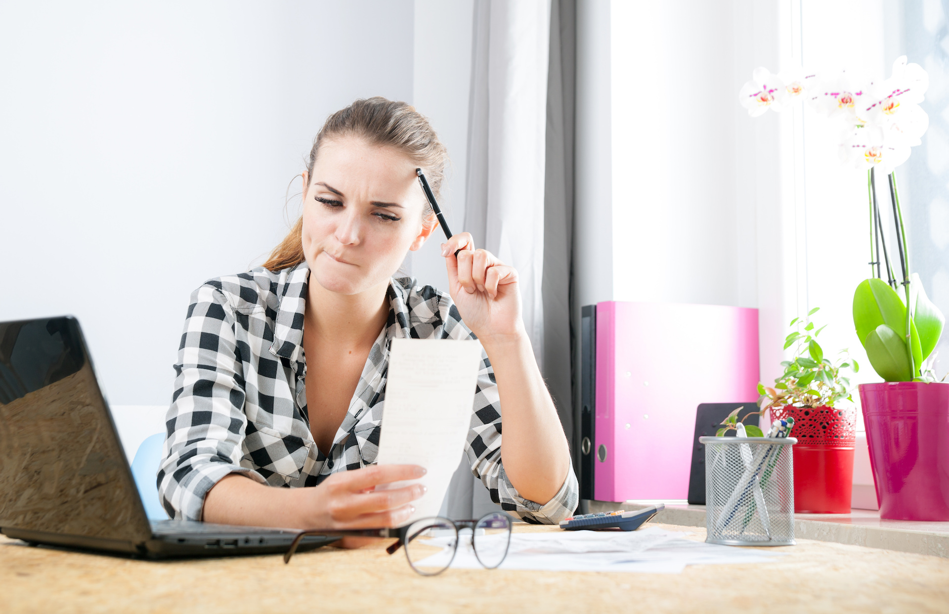 What is the cost? Young woman doing cost accounting