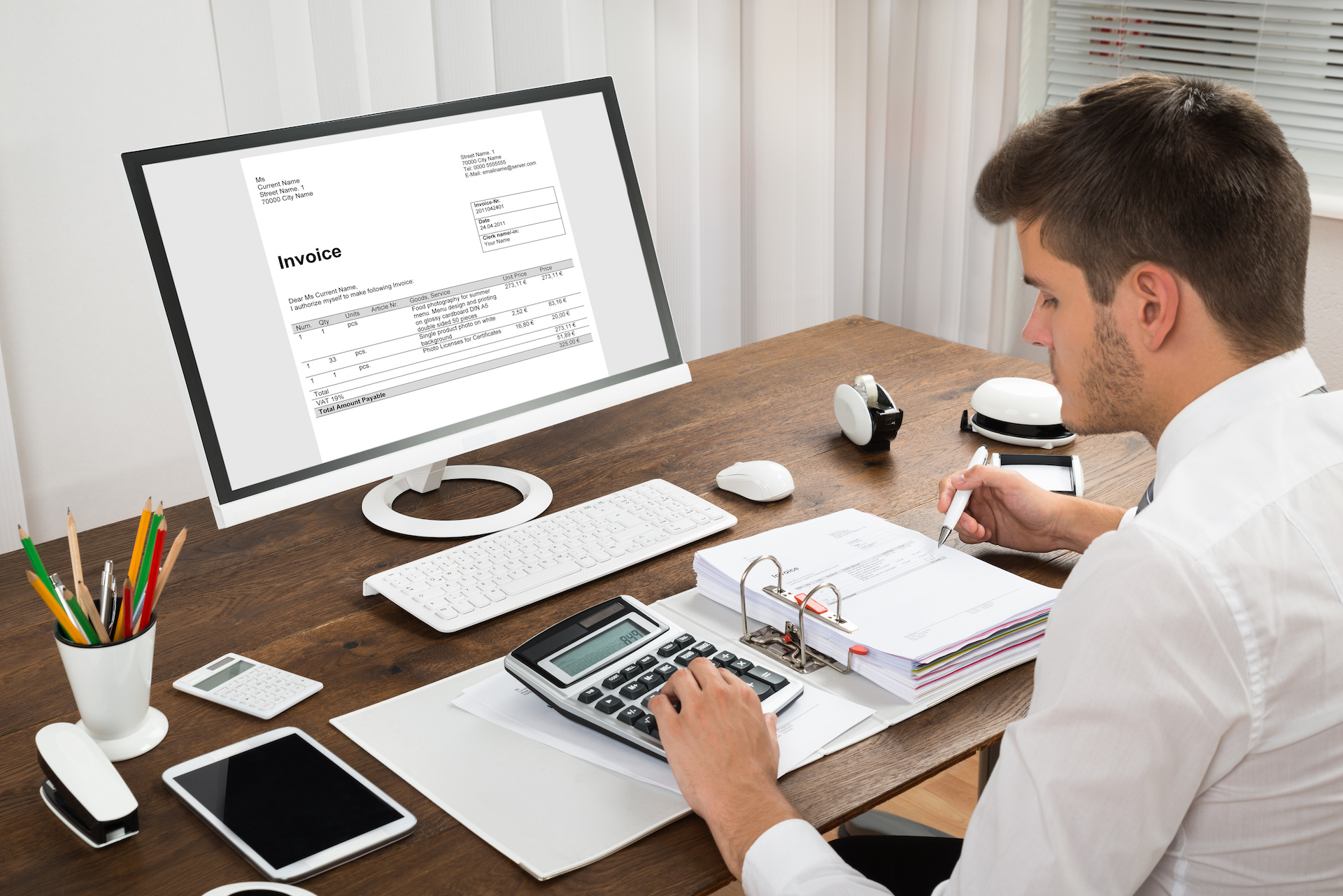 Accountant using invoice software